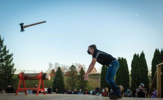 Hunter Laudate, a member of the Woodland timber team, competes in the axe throw competition during the inaugural Woodland Battle Royal on Nov. 20 at Woodland Regional High School in Beacon Falls. -JIM SHANNON/REPUBLICAN-AMERICAN