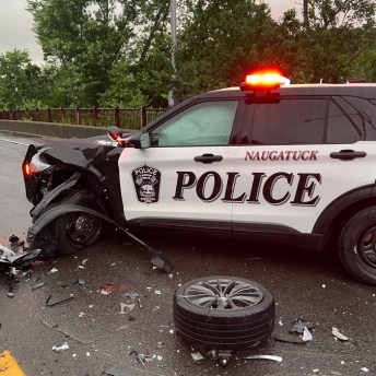 This Naugatuck police cruiser was damaged after it collided with a wrong-way driver who was fleeing from police on Route 8 southbound Friday night. –CONTRIBUTED