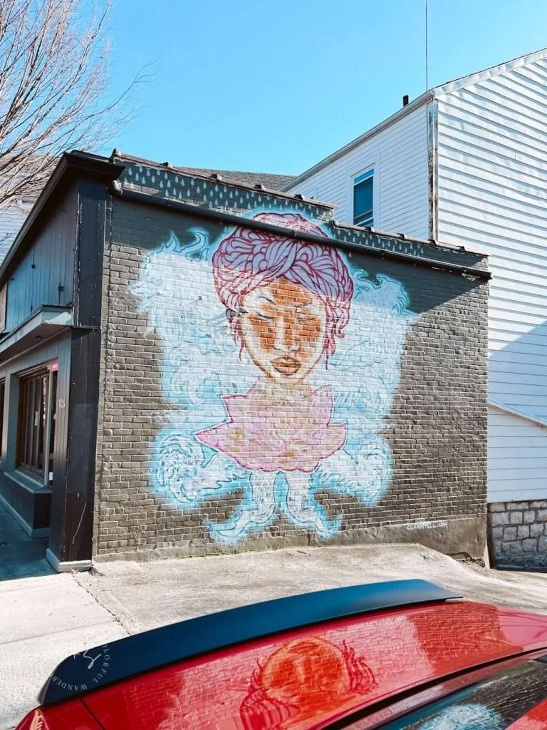 hippie flower graffiti louisville kentucky murals