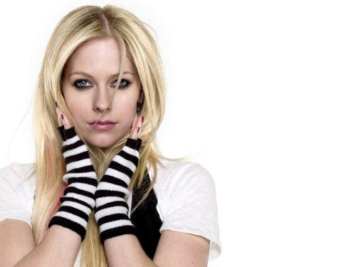 Avril Lavigne wears striped fingerless gloves