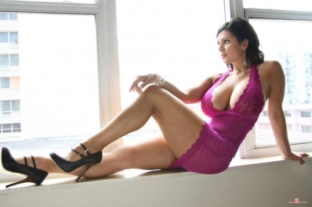 nsfw - busty window girl in pink