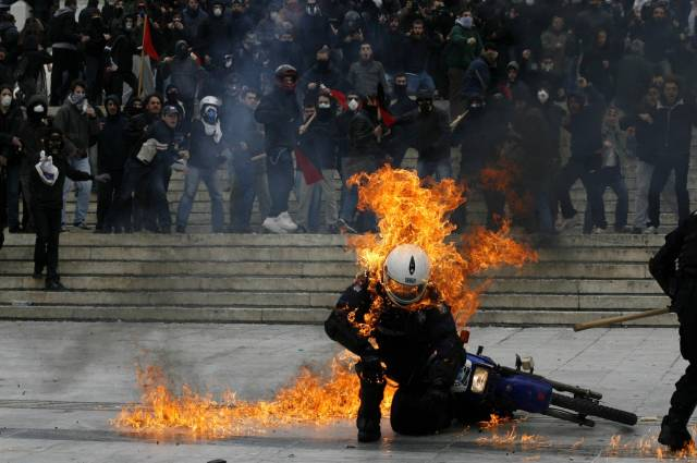 police officer hit with a molotov during 2011 greek riots