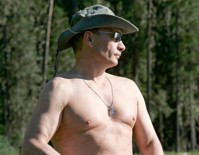 Russia's President Vladimir Putin fishes in the Yenisei River in Siberia