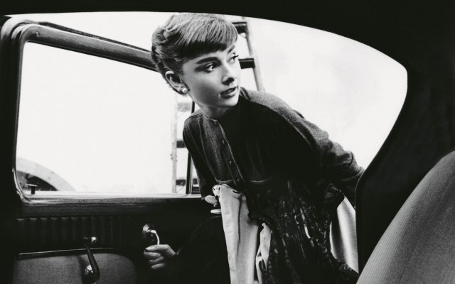 Audrey Hepburn entering a car.jpg