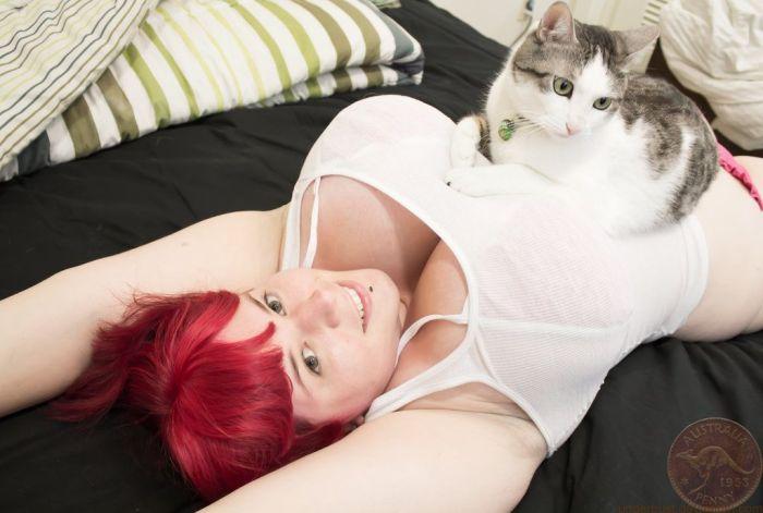 Kitten resting on boobs.jpg