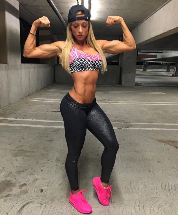 muscular woman with pink shoes.jpg
