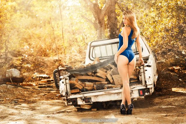 Sexy girl and a truck of wood.jpg