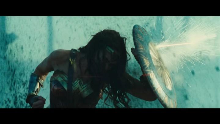 Wonder Woman hiding behind a shield.jpg