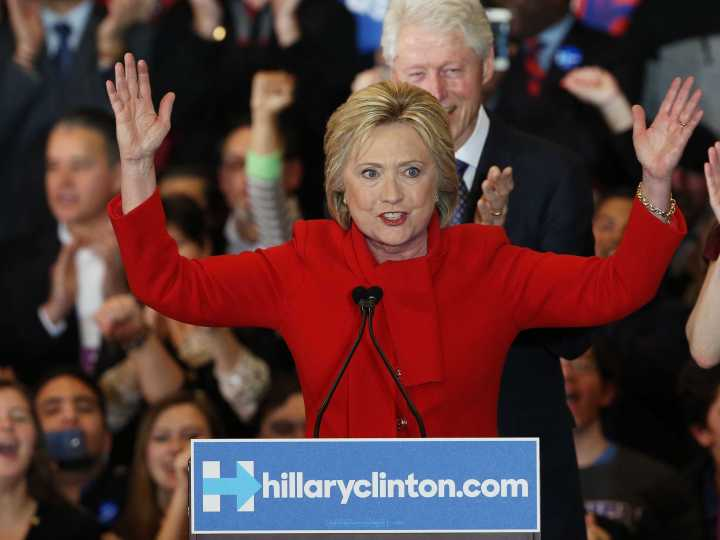 hillary shows you how large bill is.jpg