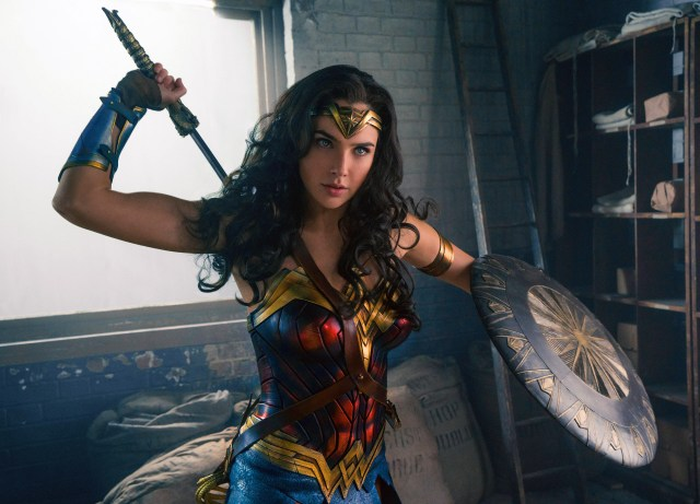 wonder woman has blue eyes and a sword.jpg
