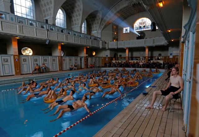 People float in a pool watching Jaws.jpg