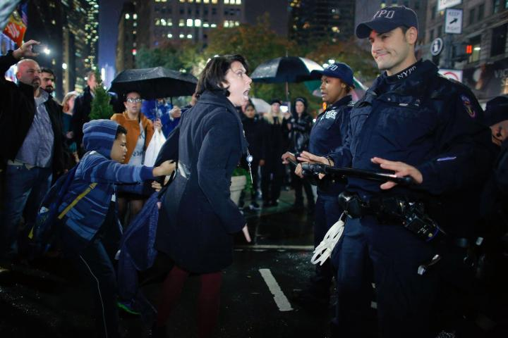 Rioter screaming at smirky NYPD officer.jpg
