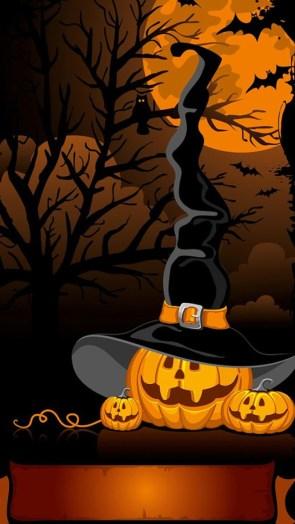 spooky witch hat on pumpkin