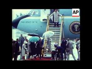 President Ford falls down airplane steps