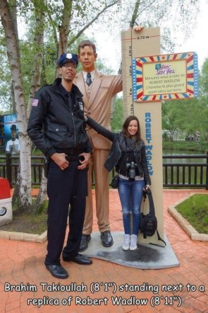 tall man and tall statue