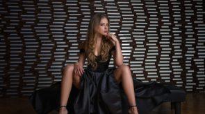 women-s-black-sleeveless-dress-sitting-high-heels-black-dress 2560?