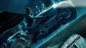 Batman going up a building on a motorcycle