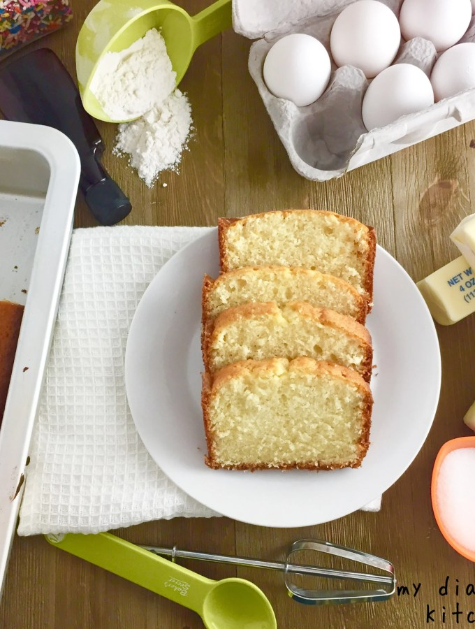 sliced pound cake surrounded by ingredients