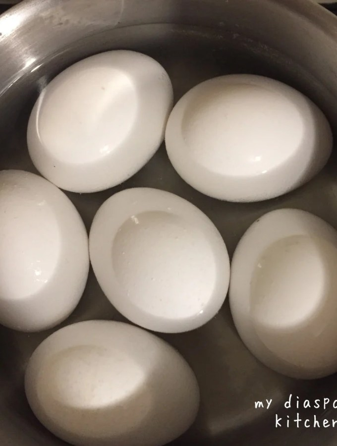 eggs boiling in a saucepan