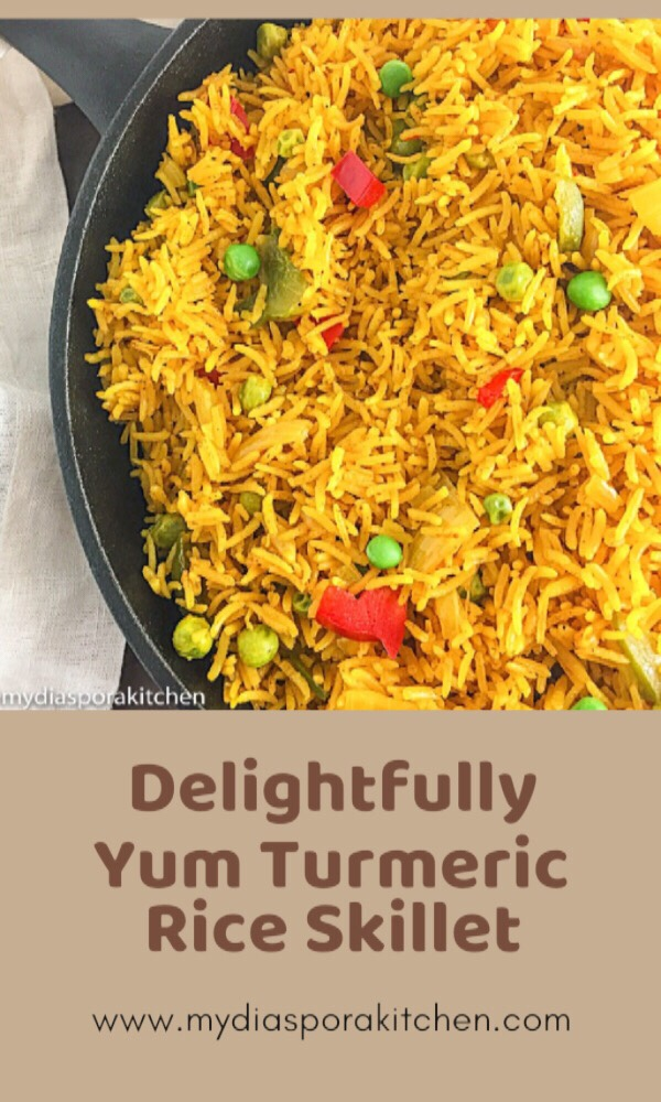 turmeric rice with veggies in a skillet