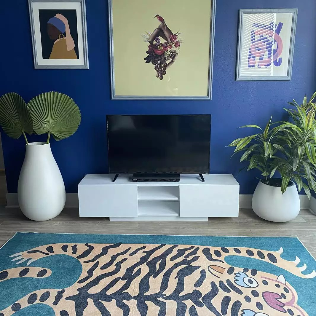Tiger rug near TV console.