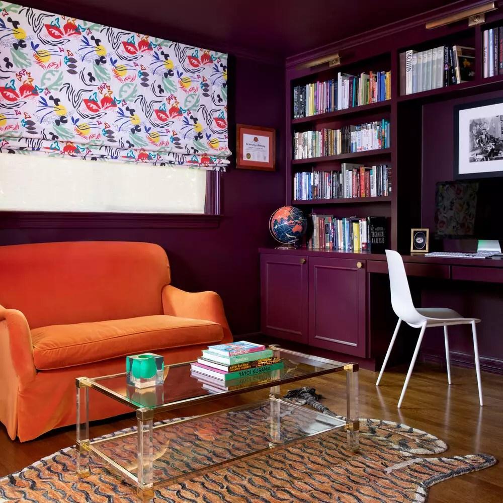 Large orange velvet oversized armchair.