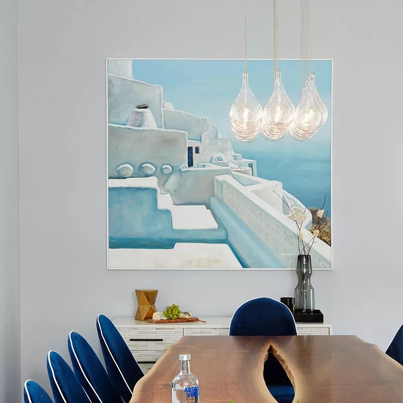 Blue dining room with wood table.