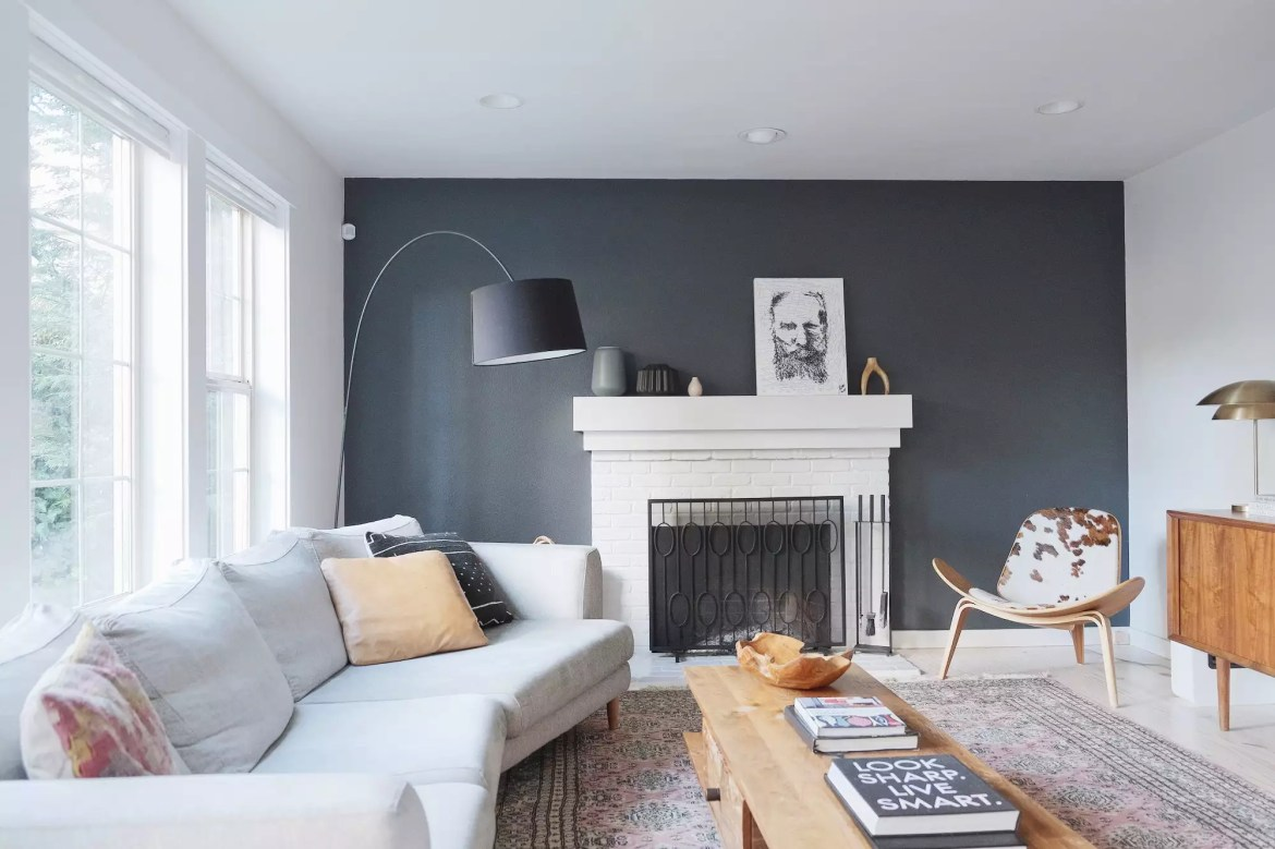 Living room with moody accent wall.