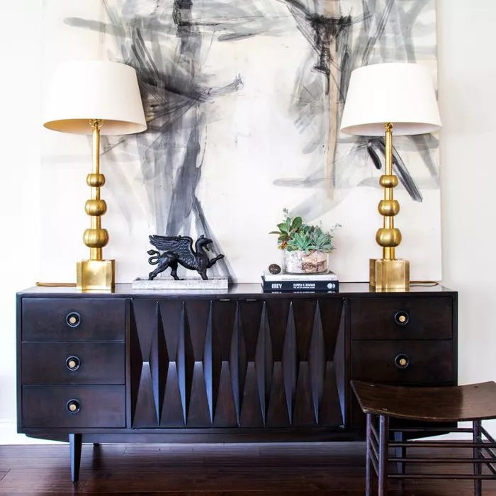 credenza with large artwork hanging above it