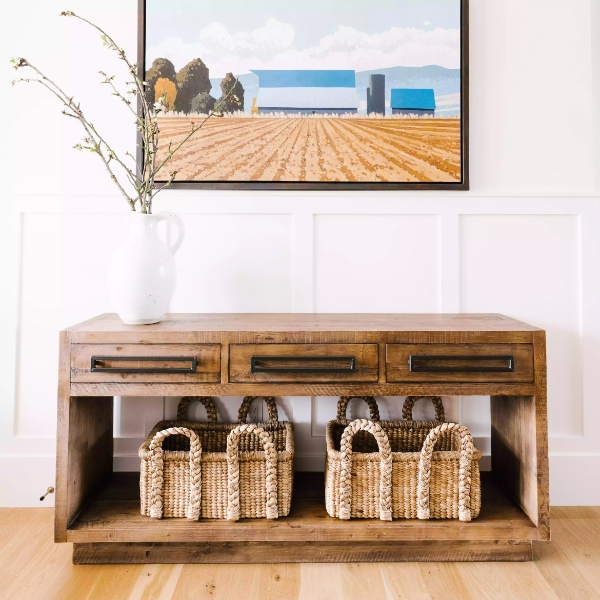 Neutral entryway with wicker baskets.