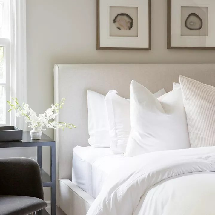 Bedroom with white linen bedding