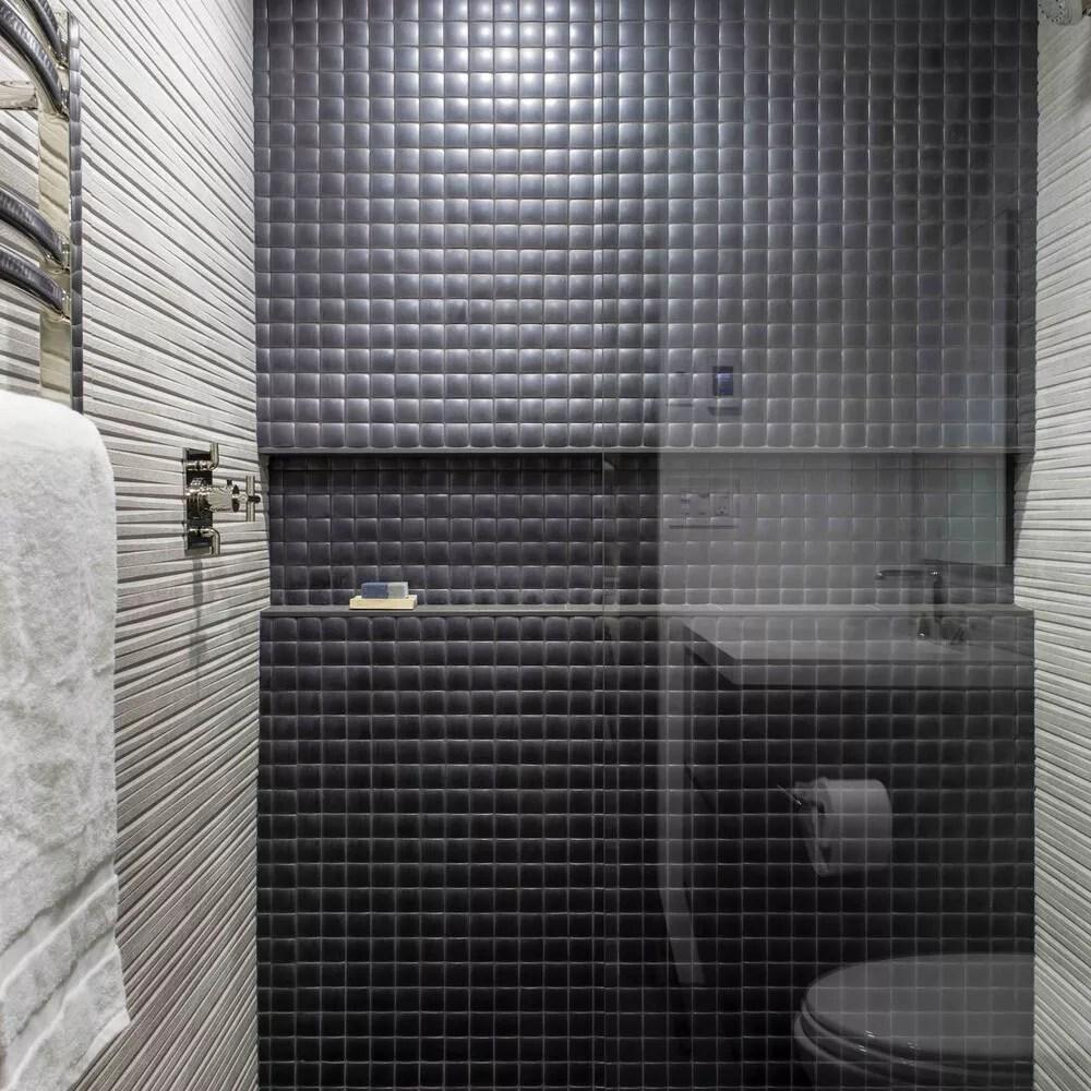 Modern bathroom with black tiles