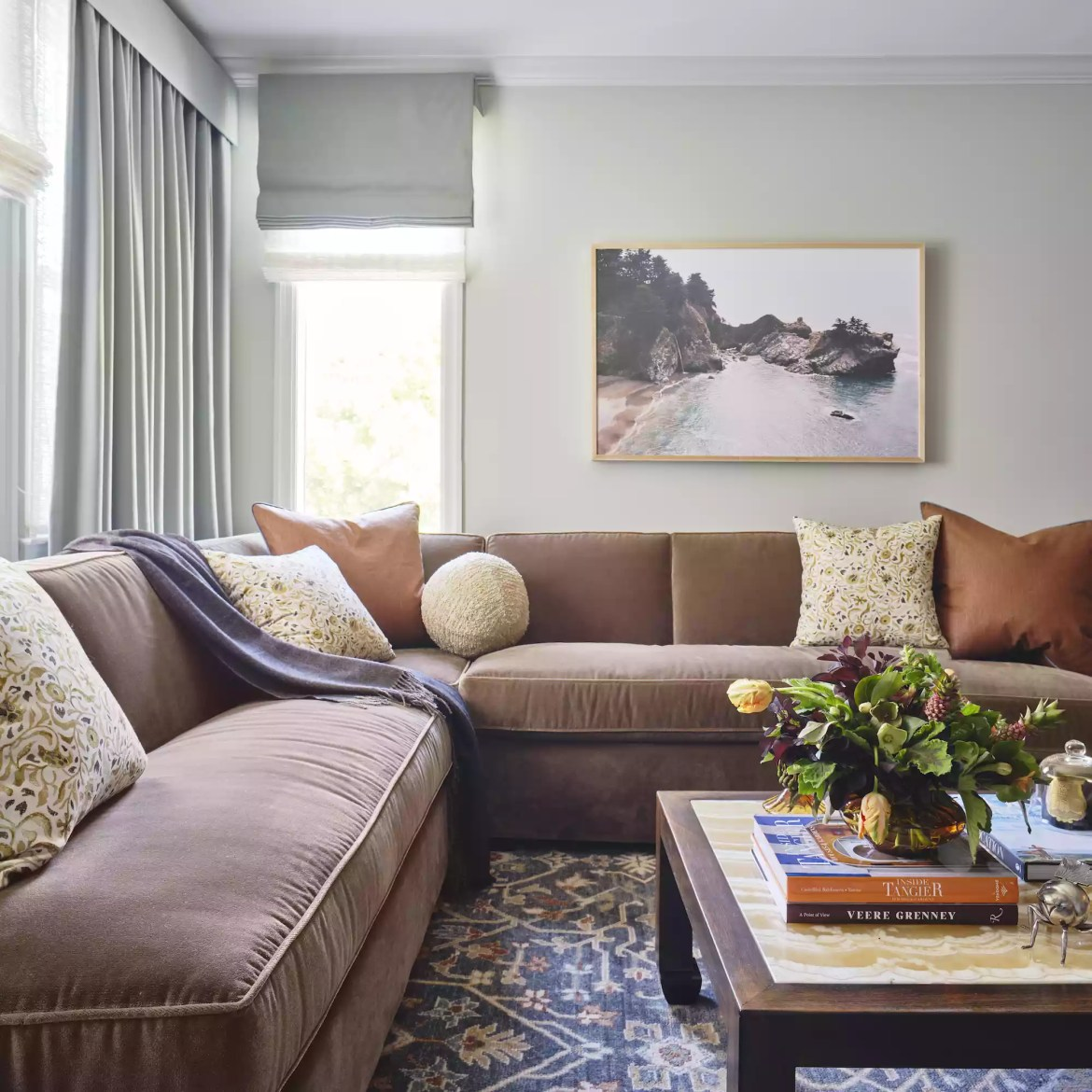 Traditional living room with large brown sectional sofa.