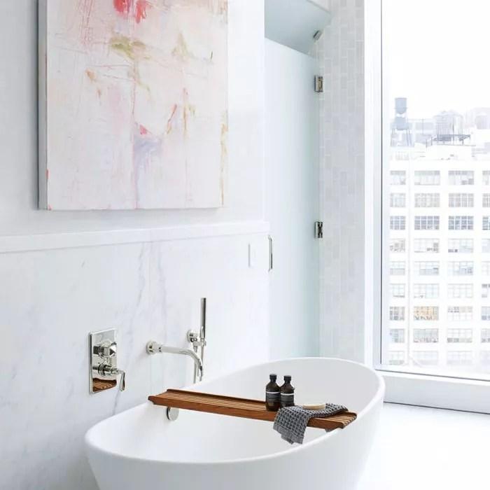 Wall art softens a minimalist bathroom
