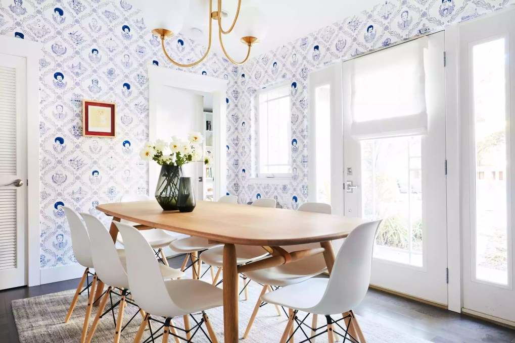 Classy dining room with toile wallpaper.