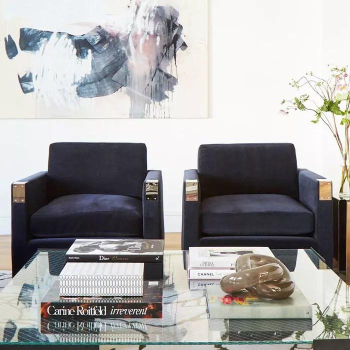 Abstract wall art mimics carpet pattern in sitting room