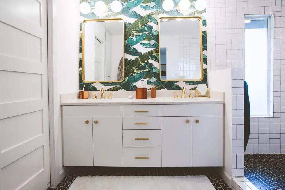 Patterned wallpaper in bathroom.