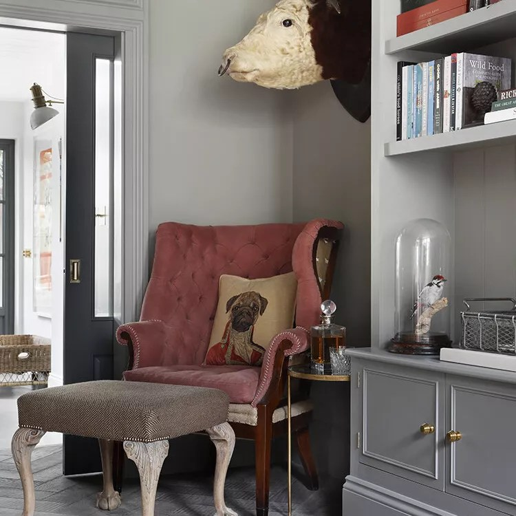 Old antique red armchair in corner.