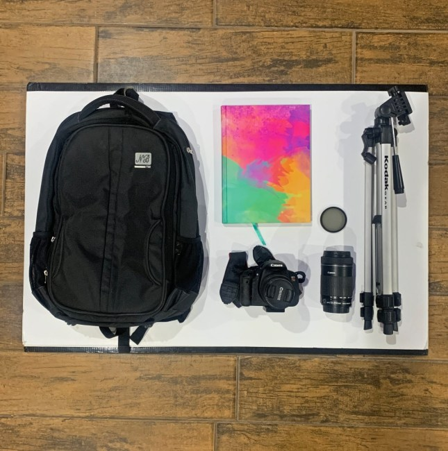 bag and notebook and camera and lens and polarizer and tripod