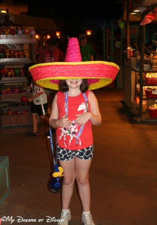 Trying on big sombreros in the Mexican Pavilion open air market!