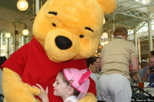 Winnie the Pooh and Sophie exchange a hug at the Crystal Palace.