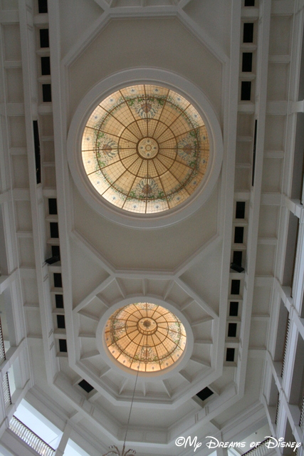 The intricate stained glass in the ceiling of the lobby.