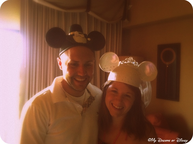 Shane and Stephanie trying on the Mickey and Minnie Bride Ear Hats that Sophie bought for them.