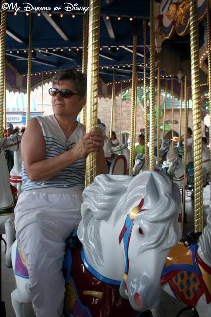 Mom riding the Carrousel!