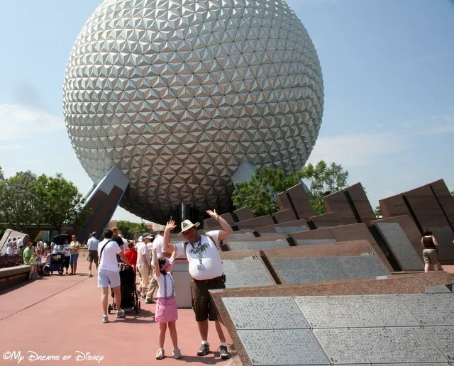 Holding up Spaceship Earth, the iconic structure of Epcot!