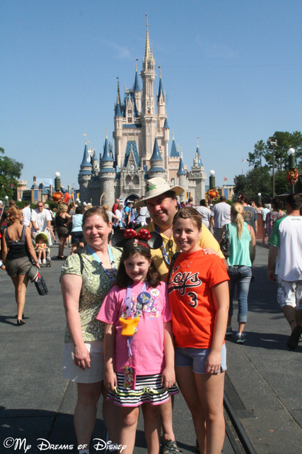 It's also in family shots in front of Cinderella Castle...