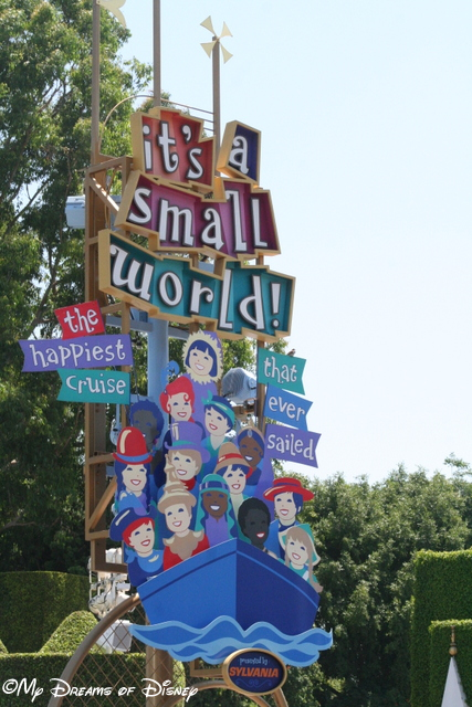 The it's a small world sign beckons you in!
