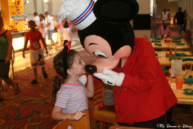 Sophie kisses Mickey's nose over at Chef Mickey's restaurant!