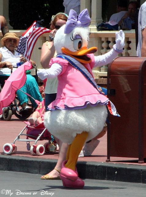 Daisy Duck waves to the crowd in the Family Fun Day Parade!
