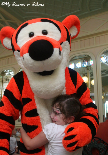 Sophie giving a Bear Hug -- or a Tigger Hug -- to Tigger!